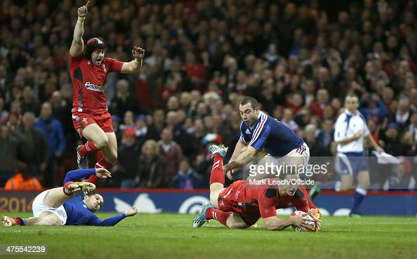 George North scores an early try for Wales celebrated by Welsh full back Leigh Halfpenny during the RBS Six Nations match between Wales and France at...