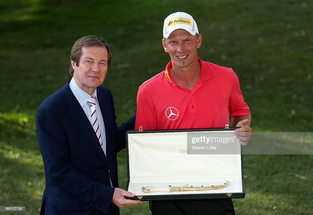 George O'Grady, Chief Executive of the European Tour poses with Marcel Siem of Germany after winning the Trophee du Hassan II Golf on a score of -17 under par at Golf du Palais Royal on March 31, 2013 in Agadir, Morocco.