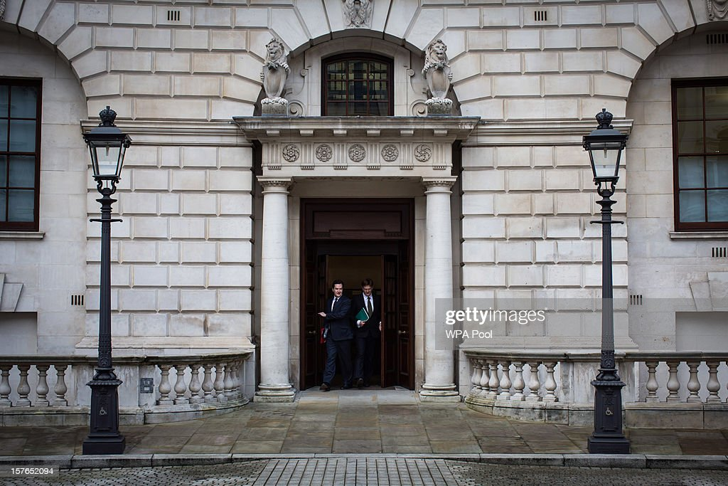 <a gi-track='captionPersonalityLinkClicked' href=/galleries/search?phrase=George+Osborne&family=editorial&specificpeople=5544226 ng-click='$event.stopPropagation()'>George Osborne</a>, Chancellor of the Exchequer and Danny Alexander, the Chief Secretary to the Treasury leave the Treasury to deliver the half-yearly budget statement to parliament, on December 5, 2012 in London, England. The Chancellor is expected to say that there is no miracle cure for the United Kingdom's financial woes, as the economy struggles for growth, when he delivers his Autumn Statement later in Parliament.