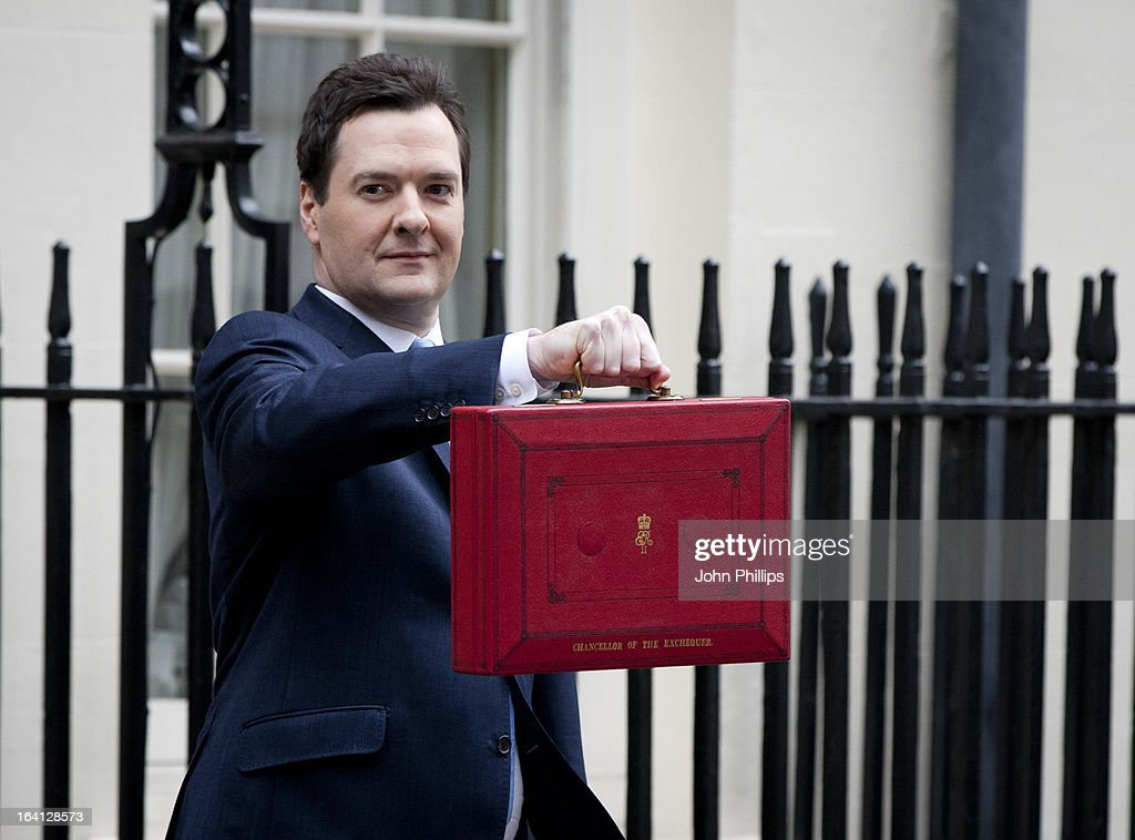 <a gi-track='captionPersonalityLinkClicked' href=/galleries/search?phrase=George+Osborne&family=editorial&specificpeople=5544226 ng-click='$event.stopPropagation()'>George Osborne</a>, the Chancellor of the Exchequer, poses before presenting his annual budget to Parliament, outside 11 Downing Street on March 20, 2013 in London, England. The Chancellor, under pressure after the UK lost its AAA credit rating last month and the lack of growth in the economy, is predicted to reveal plans to continue with his austerity strategy to cut the UK's deficit. It is likely that Mr. Osborne will announce further spending cuts to Whitehall departments with the savings put in place to boost large scale infrastructure projects, with both tax breaks on childcare and a rise in fuel duty also high on the agenda.