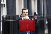 George Osborne UK chancellor of the exchequer holds the dispatch box containing the 2014 budget as he stands outside 11 Downing Street in London UK...
