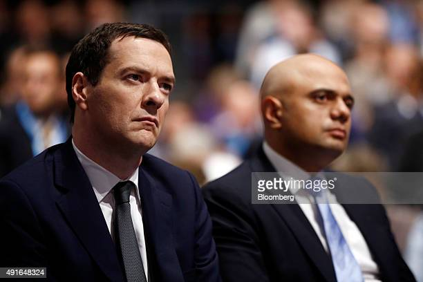 George Osborne UK chancellor of the exchequer left and Sajid Javid UK business secretary listen to David Cameron UK prime minister and leader of the...