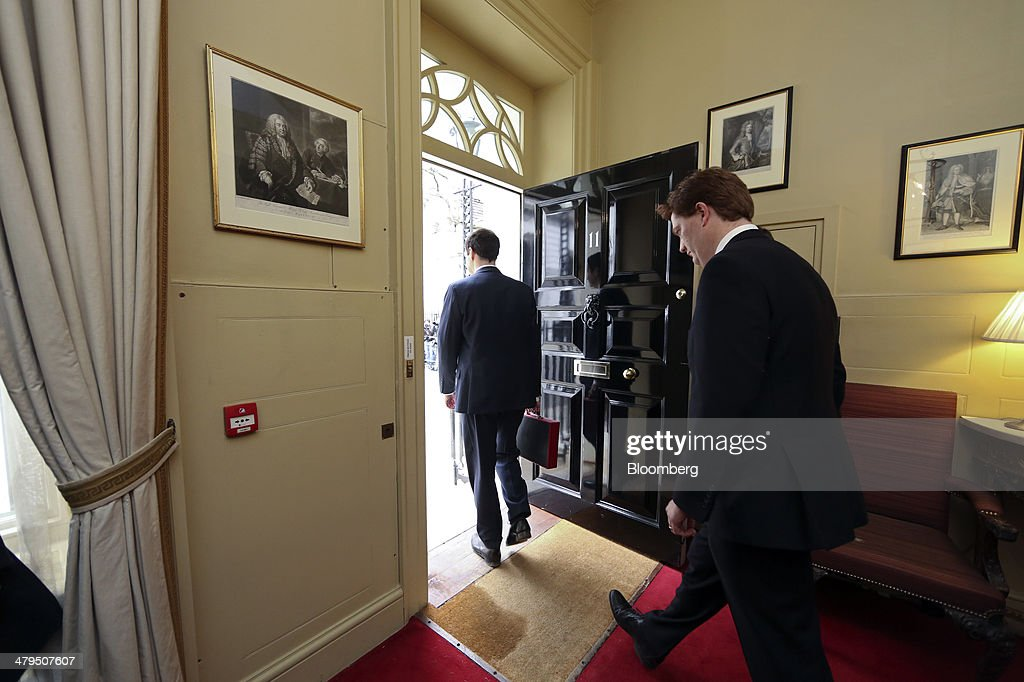 <a gi-track='captionPersonalityLinkClicked' href=/galleries/search?phrase=George+Osborne&family=editorial&specificpeople=5544226 ng-click='$event.stopPropagation()'>George Osborne</a>, U.K. chancellor of the exchequer, left, carries the dispatch box containing the 2014 budget as he and <a gi-track='captionPersonalityLinkClicked' href=/galleries/search?phrase=Danny+Alexander+-+Politician&family=editorial&specificpeople=6897330 ng-click='$event.stopPropagation()'>Danny Alexander</a>, U.K. chief secretary to the treasury, leave 11 Downing Street in London, U.K., on Wednesday, March 19, 2014. Osborne will lay out a budget today focused on securing Britain's economic recovery and rebutting opposition Labour Party claims that he's ignoring the rising cost of living. Photographer: Chris Ratcliffe/Bloomberg via Getty Images