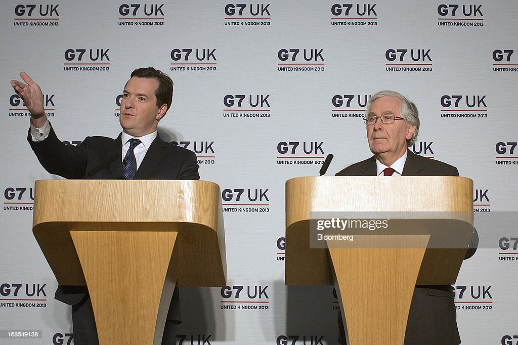 <a gi-track='captionPersonalityLinkClicked' href=/galleries/search?phrase=George+Osborne&family=editorial&specificpeople=5544226 ng-click='$event.stopPropagation()'>George Osborne</a>, U.K. chancellor of the exchequer, left, gestures as <a gi-track='captionPersonalityLinkClicked' href=/galleries/search?phrase=Mervyn+King+-+Economist&family=editorial&specificpeople=14888473 ng-click='$event.stopPropagation()'>Mervyn King</a>, governor of the Bank of England, looks on during a news conference at the Group of Seven (G-7) finance ministers and central bank governors meeting at Hartwell House in Aylesbury, U.K., on Saturday, May 11, 2013. Global finance chiefs clashed over the correct speed of budget cutting as they sought fresh ways to rally the slowing world economy. Photographer: Simon Dawson/Bloomberg via Getty Images