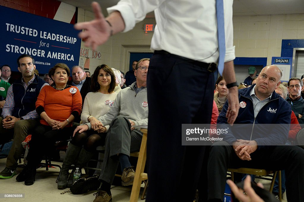 George P. Bush (L) and Columba Bush listen as Republican Presidential candidate Jeb Bush speaks at a town hall at Woodbury School February 7, 2016 in Salem, New Hampshire. Candidates are in a last push for votes ahead of the first in the nation primary on February 9.
