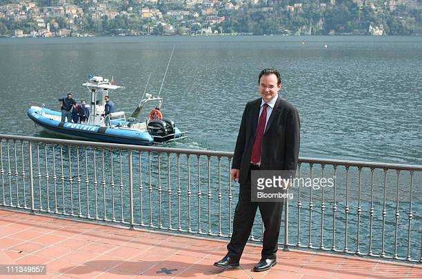 George Papaconstantinou Greece's finance minister poses for a photograph during the Ambrosetti Workshop in Cernobbio near Como Italy on Friday April...