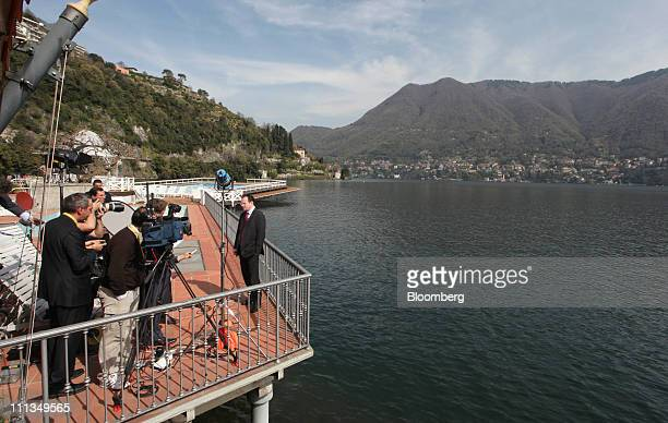 George Papaconstantinou Greece's finance minister right is seen during a television interview at the Ambrosetti Workshop in Cernobbio near Como Italy...