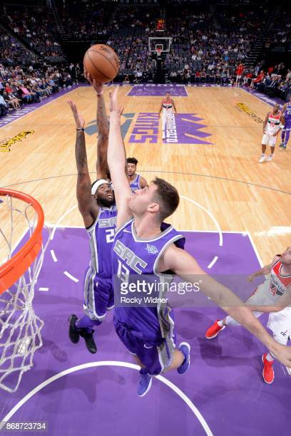 George Papagiannis and JaKarr Sampson of the Sacramento Kings rebound against the Washington Wizards on October 29 2017 at Golden 1 Center in...