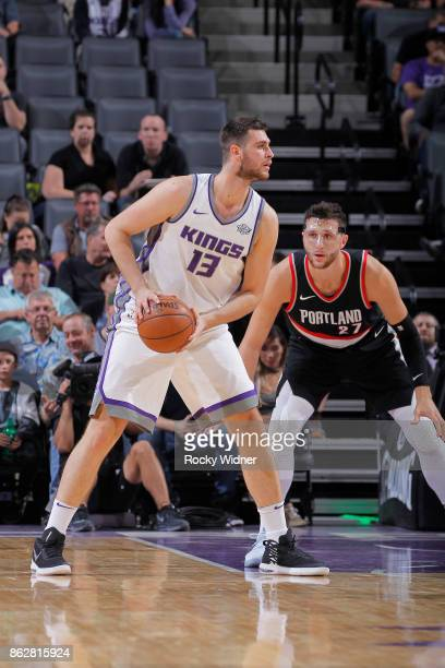 George Papagiannis of the Sacramento Kings handles the ball against Jusuf Nurkic of the Portland Trail Blazers on October 9 2017 at Golden 1 Center...