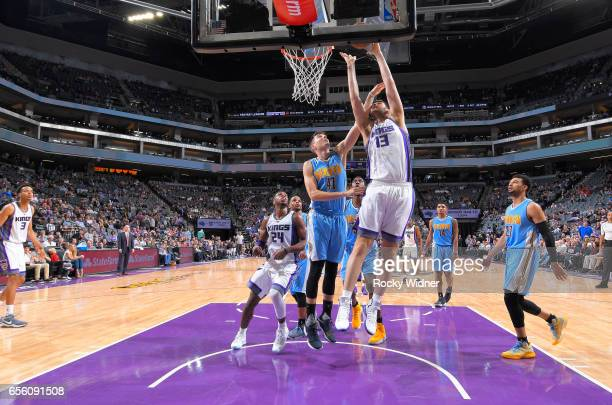 George Papagiannis of the Sacramento Kings shoots a layup against Juan Hernangomez of the Denver Nuggets on March 11 2017 at Golden 1 Center in...