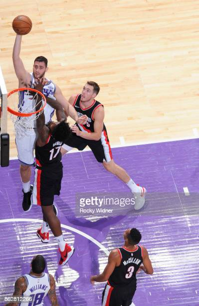 George Papagiannis of the Sacramento Kings shoots against Ed Davis of the Portland Trail Blazers on October 9 2017 at Golden 1 Center in Sacramento...
