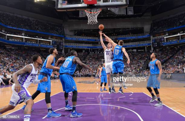 George Papagiannis of the Sacramento Kings shoots against Jarrod Uthoff of the Dallas Mavericks on April 4 2017 at Golden 1 Center in Sacramento...