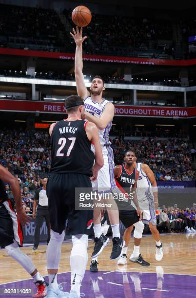 George Papagiannis of the Sacramento Kings shoots against Jusuf Nurkic of the Portland Trail Blazers on October 9 2017 at Golden 1 Center in...
