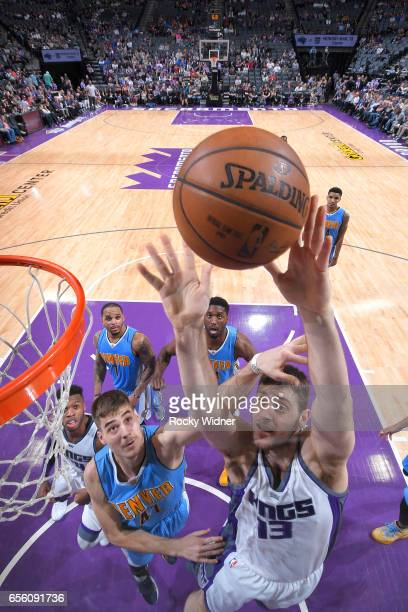 George Papagiannis of the Sacramento Kings shots a layup against Juan Hernangomez of the Denver Nuggets on March 11 2017 at Golden 1 Center in...