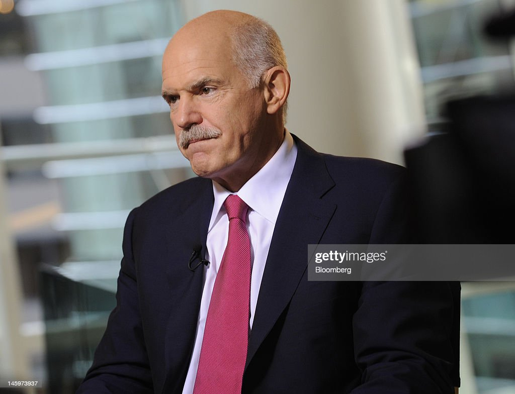 <a gi-track='captionPersonalityLinkClicked' href=/galleries/search?phrase=George+Papandreou&family=editorial&specificpeople=212855 ng-click='$event.stopPropagation()'>George Papandreou</a>, former prime minister of Greece, listens during an interview in New York, U.S., on Friday, June 8, 2012. Papandreou predicted that Greece will stay a member of the euro zone and said he thought the austerity measures required by the nation's bailouts might be eased. Photographer: Louis Lanzano/Bloomberg via Getty Images