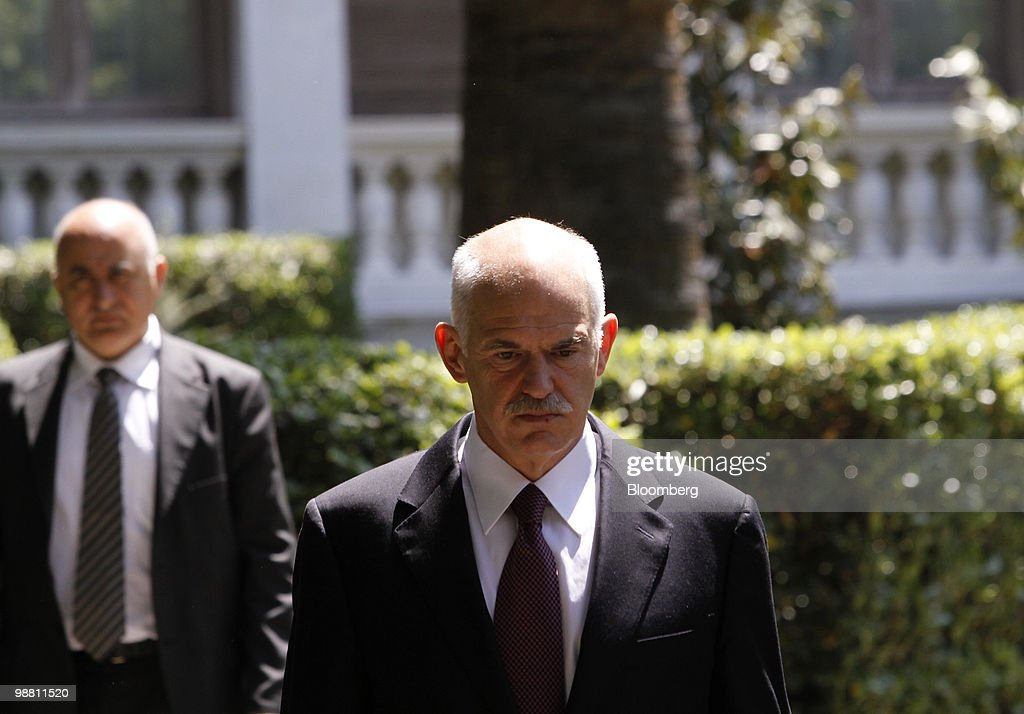 George Papandreou, Greece's prime minister, center, leaves the presidential palace following a meeting with Karolos Papoulias, Greece's president, in Athens, Greece, on Monday, May 3, 2010. Papandreou's call for Greeks to accept more sacrifices in return for staving off default was rejected by opposition leaders and unions, which are already organizing more protests. Photographer: Kostas Tsironis/Bloomberg via Getty Images