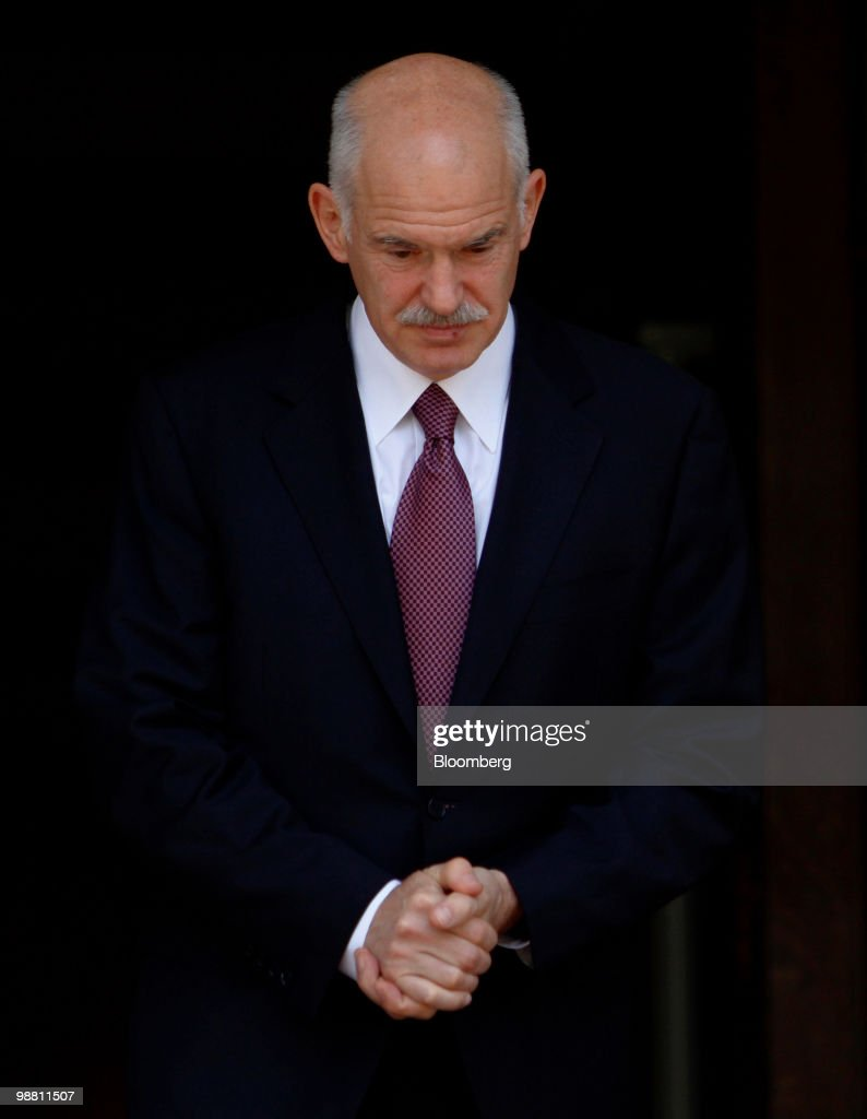 George Papandreou, Greece's prime minister, exits his office in Athens, Greece, on Monday, May 3, 2010. Papandreou's call for Greeks to accept more sacrifices in return for staving off default was rejected by opposition leaders and unions, which are already organizing more protests. Photographer: Kostas Tsironis/Bloomberg via Getty Images