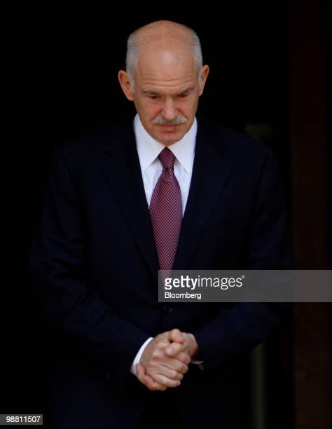 George Papandreou Greece's prime minister exits his office in Athens Greece on Monday May 3 2010 Papandreou's call for Greeks to accept more...