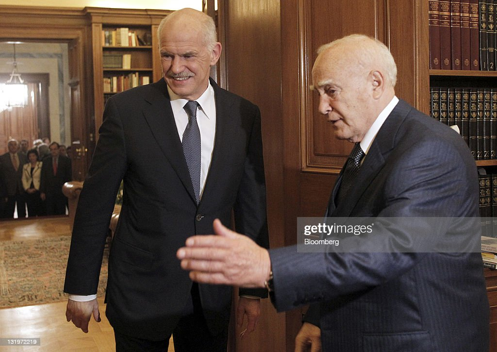 George Papandreou, Greece's prime minister, left, arrives for a meeting with Karolos Papoulias, Greece's president, at the presidential palace in Athens, Greece, on Wednesday, Nov. 9, 2011. Papandreou will step down after announcing an agreement with the main opposition party on an interim unity government charged with averting the economy's collapse. Photographer: Petros Giannakouris/Pool via Bloomberg via Getty Images