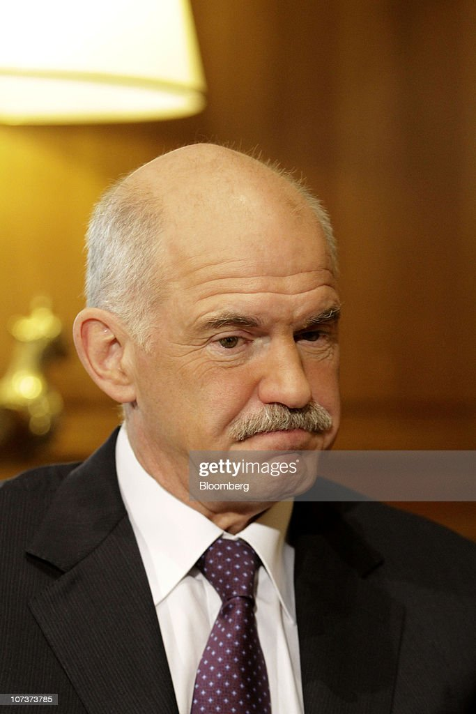 George Papandreou Greece's prime minister pauses during a meeting with Dominique StraussKahn managing director of the International Monetary Fund at...