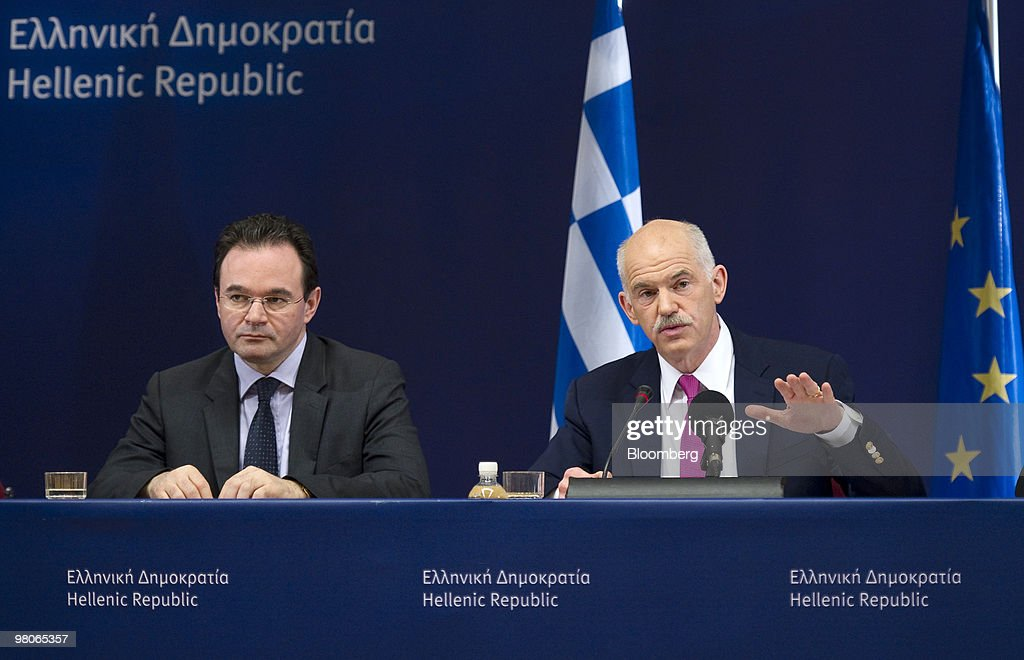 George Papandreou, Greece's prime minister, right, speaks as George Papaconstantinou, Greece's finance minister, listens during a press conference following the European Union Summit in Brussels, Belgium, on Friday, March 26, 2010. French President Nicolas Sarkozy capped a week of reversals with his acceptance of German demands on a contingency plan to aid Greece. Photographer: Jock Fistick/Bloomberg via Getty Images