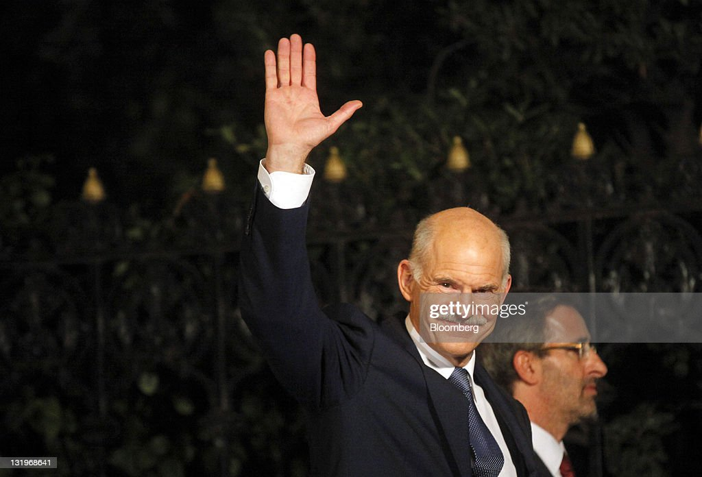 <a gi-track='captionPersonalityLinkClicked' href=/galleries/search?phrase=George+Papandreou&family=editorial&specificpeople=212855 ng-click='$event.stopPropagation()'>George Papandreou</a>, Greece's prime minister, waves as he arrives at the presidential palace in Athens, Greece, on Wednesday, Nov. 9, 2011. Papandreou will step down after announcing an agreement with the main opposition party on an interim Greek government charged with averting the economy's collapse. Photographer: Kostas Tsironis/Bloomberg via Getty Images