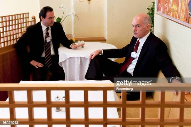 George Papandreou prime minister of Greece right has a private meeting with George Papaconstantinou Greek finance minister on day three of the 2010...