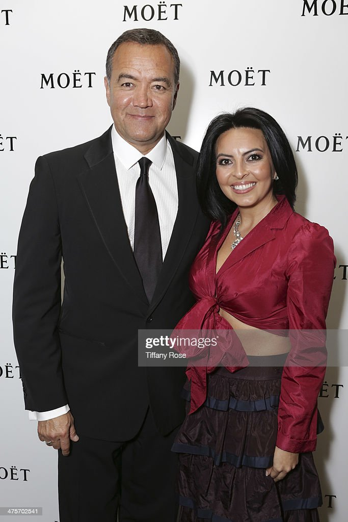George Parra and Lisa Leyva attend Moet At The 17th Annual National Hispanic Media Coalition Impact Awards at the Beverly Wilshire Four Seasons Hotel on February 28, 2014 in Beverly Hills, California.