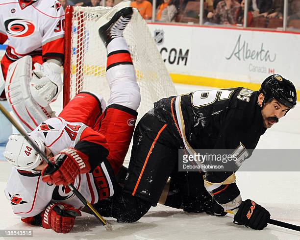 George Parros of the Anaheim Ducks battles with Jay Harrison of the Carolina Hurricanes during the game on February 8 2012 at Honda Center in Anaheim...