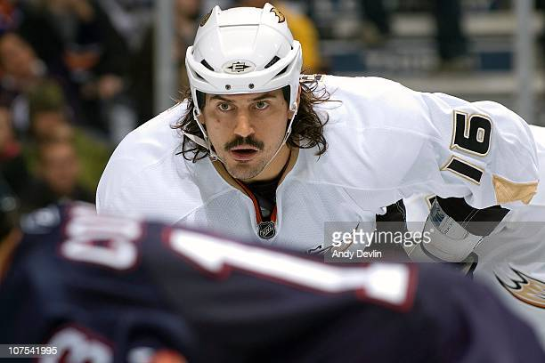 George Parros of the Anaheim Ducks concentrates on the puck against the Edmonton Oilers at Rexall Place on December 7 2010 in Edmonton Alberta Canada...