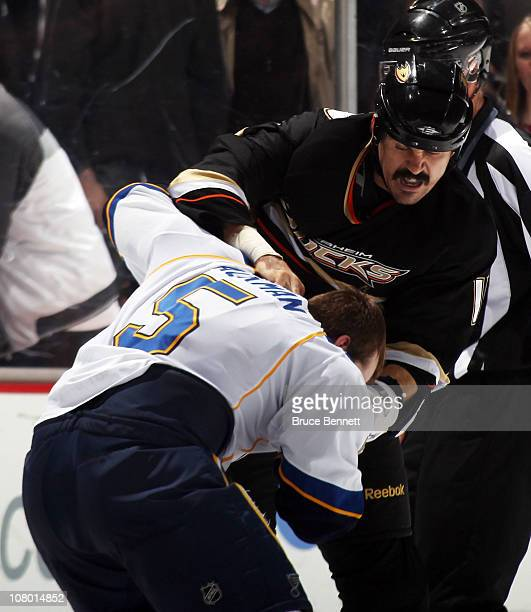 George Parros of the Anaheim Ducks fights with Barret Jackman of the St Louis Blues during the third period at the Honda Center on January 12 2011 in...