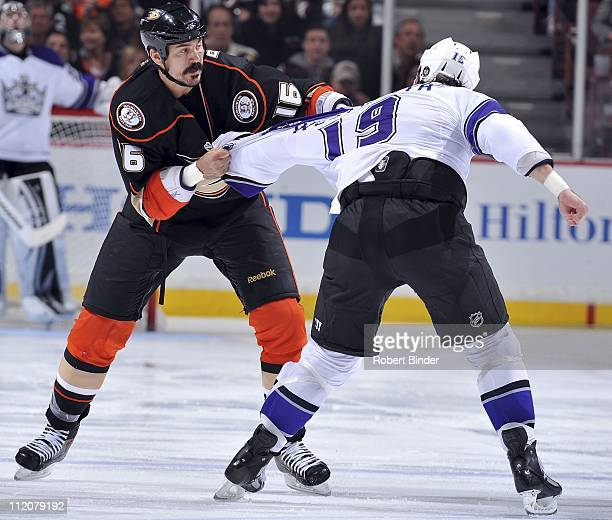 George Parros of the Anaheim Ducks fights with Kevin Westgarth of the Los Angeles Kings during the game at Honda Center on April 8 2011 in Anaheim...