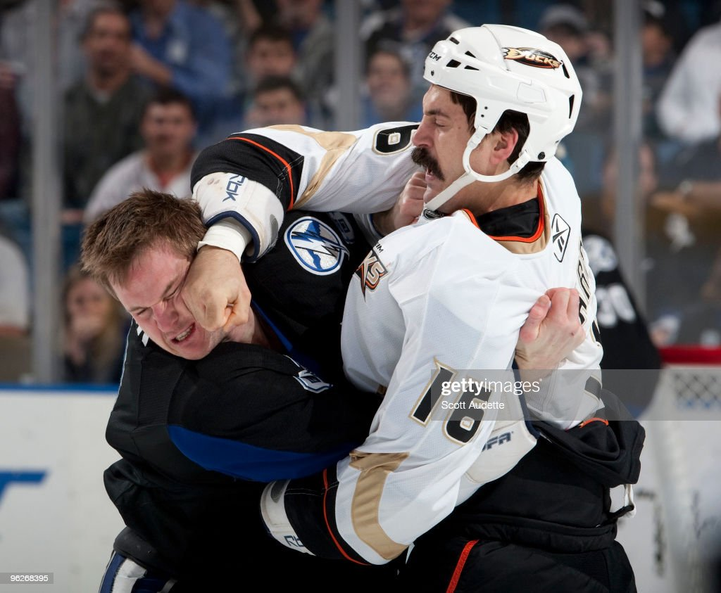 <a gi-track='captionPersonalityLinkClicked' href=/galleries/search?phrase=George+Parros&family=editorial&specificpeople=557239 ng-click='$event.stopPropagation()'>George Parros</a> #16 of the Anaheim Ducks fights with <a gi-track='captionPersonalityLinkClicked' href=/galleries/search?phrase=Matt+Walker+-+Ice+Hockey+Player&family=editorial&specificpeople=240181 ng-click='$event.stopPropagation()'>Matt Walker</a> #8 of the Tampa Bay Lightning during the first period at the St. Pete Times Forum on January 29, 2010 in Tampa, Florida.
