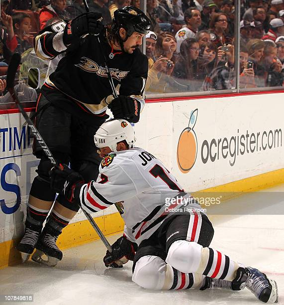 George Parros of the Anaheim Ducks gets tangled up with Ryan Johnson of the Chicago Blackhawks during the game on January 2 2011 at Honda Center in...