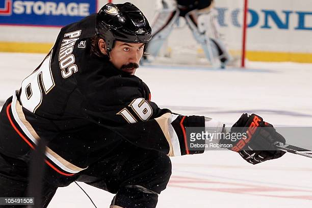 George Parros of the Anaheim Ducks passes the puck during the game Vancouver Canucks on October 13 2010 at Honda Center in Anaheim California