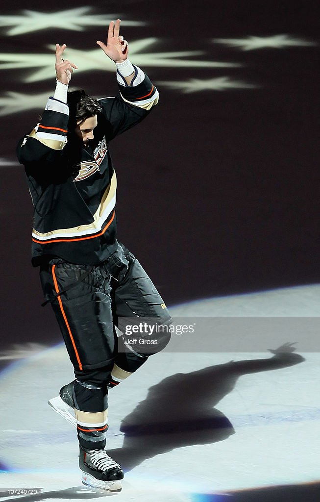 <a gi-track='captionPersonalityLinkClicked' href=/galleries/search?phrase=George+Parros&family=editorial&specificpeople=557239 ng-click='$event.stopPropagation()'>George Parros</a> #16 of the Anaheim Ducks reacts to the fans after being named the first star of the game against the Florida Panthers at the Honda Center on December 1, 2010 in Anaheim, California. The Ducks defeated the Panthers 5-3.