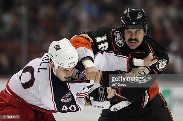 George Parros of the Anaheim Ducks throws a punch at Jared Boll of the Columbus Blue Jackets in the first period at the Honda Center on January 7...
