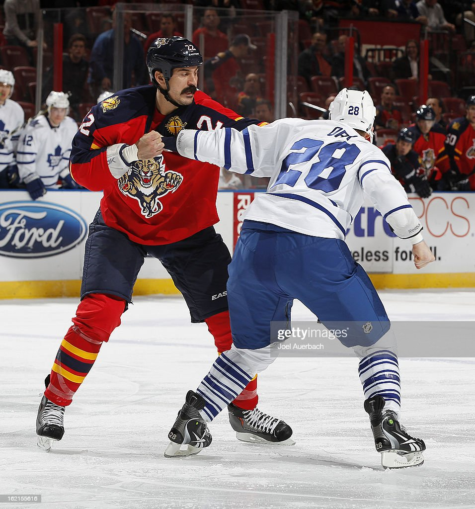 George Parros #22 of the Florida Panthers and Colton Orr #28 of the Toronto Maple Leafs fight during first period action at the BB&T Center on February 18, 2013 in Sunrise, Florida. The Maple Leafs defeated the Panthers 3-0.