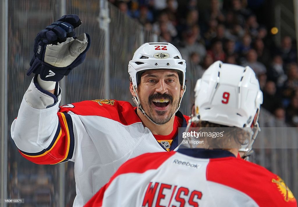 George Parros #22 of the Florida Panthers celebrates his second period goal against the Buffalo Sabres with teammate Stephen Weiss #9 on February 3, 2013 at the First Niagara Center in Buffalo, New York.