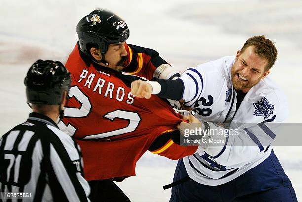 George Parros of the Florida Panthers fights with Colton Orr of the Toronto Maple Leafs during a NHL game at the BBT Center on February 18 2013 in...