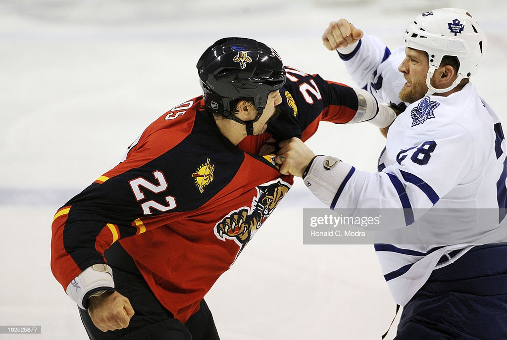 George Parros #22 of the Florida Panthers fights with Colton Orr #28 of the Toronto Maple Leafs during a NHL game at the BB&T Center on February 18, 2013 in Sunrise, Florida.