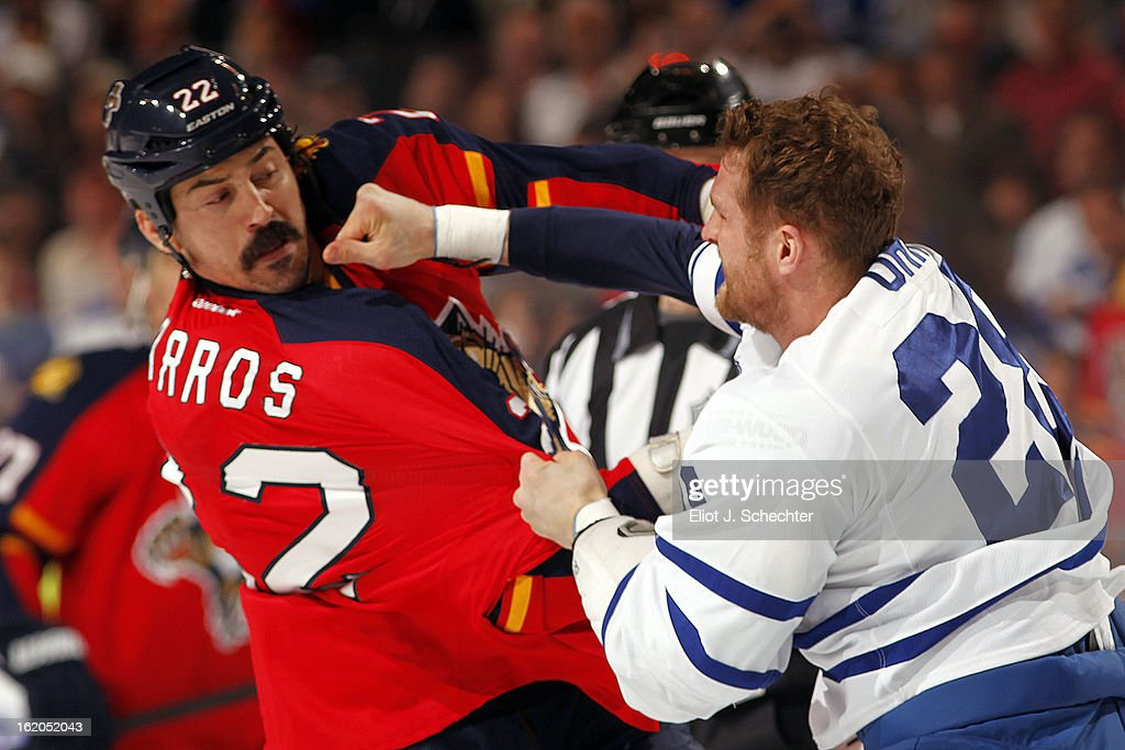 George Parros #22 of the Florida Panthers fights with Colton Orr #28 Toronto Maple Leafs at the BB&T Center on February 18, 2013 in Sunrise, Florida.