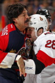 George Parros of the Florida Panthers fights with Matt Kassian of the Ottawa Senators at the BBT Center on April 7 2013 in Sunrise Florida
