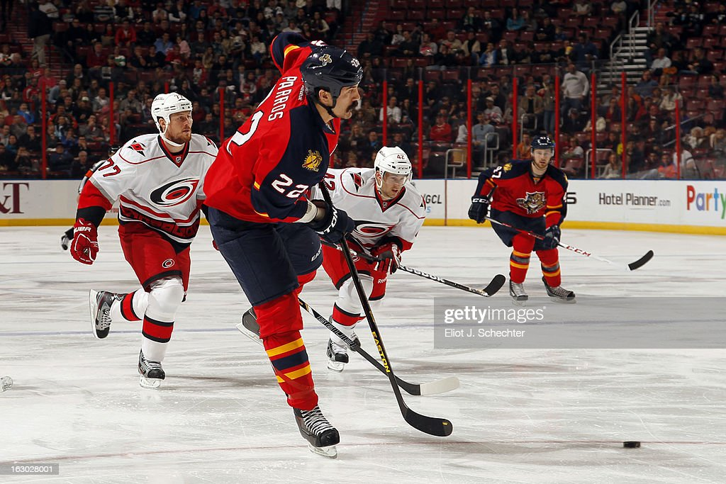 George Parros #22 of the Florida Panthers passes the puck against the Carolina Hurricanes at the BB&T Center on March 3, 2013 in Sunrise, Florida.