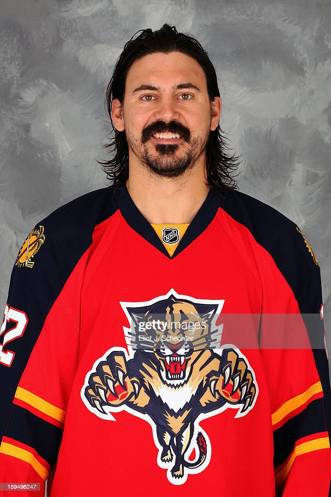 <a gi-track='captionPersonalityLinkClicked' href=/galleries/search?phrase=George+Parros&family=editorial&specificpeople=557239 ng-click='$event.stopPropagation()'>George Parros</a> of the Florida Panthers poses for his official headshot for the 2012-2013 NHL season on January 13, 2013 in Coral Springs, Florida.