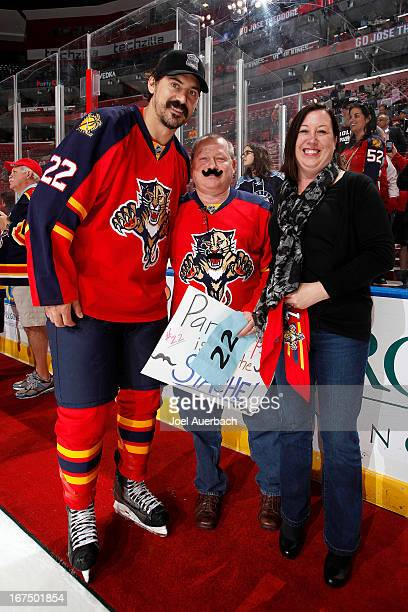 George Parros of the Florida Panthers poses with fans who purchased his game jersey in a silent auction after the game against the New York Rangers...