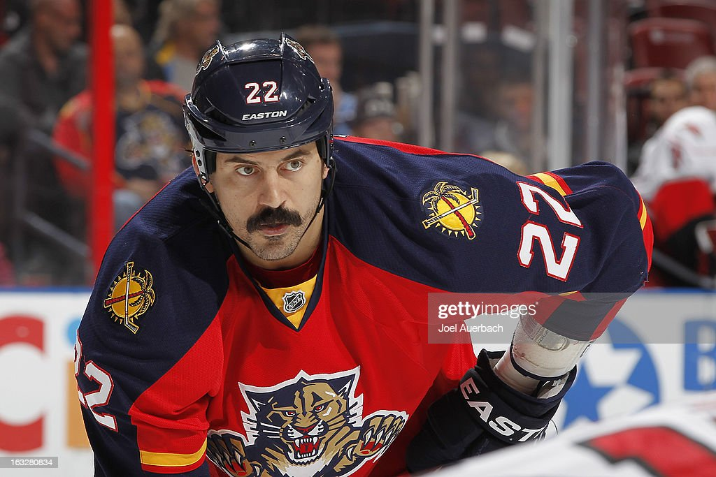 George Parros #22 of the Florida Panthers prepares for a face off against the Carolina Hurricanes at the BB&T Center on March 3, 2013 in Sunrise, Florida. The Hurricanes defeated the Panthers 3-2.