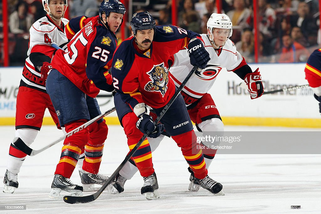 George Parros #22 of the Florida Panthers skates for possession against the Carolina Hurricanes at the BB&T Center on March 3, 2013 in Sunrise, Florida.