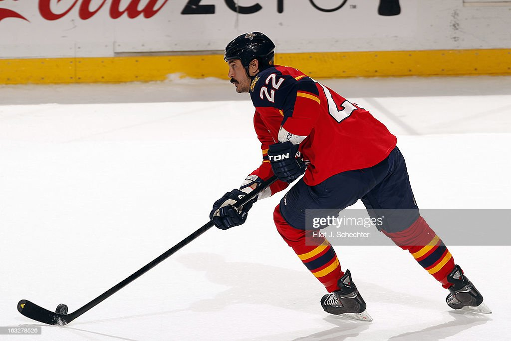 George Parros #22 of the Florida Panthers skates with the puck against the Winnipeg Jets at the BB&T Center on March 5, 2013 in Sunrise, Florida.
