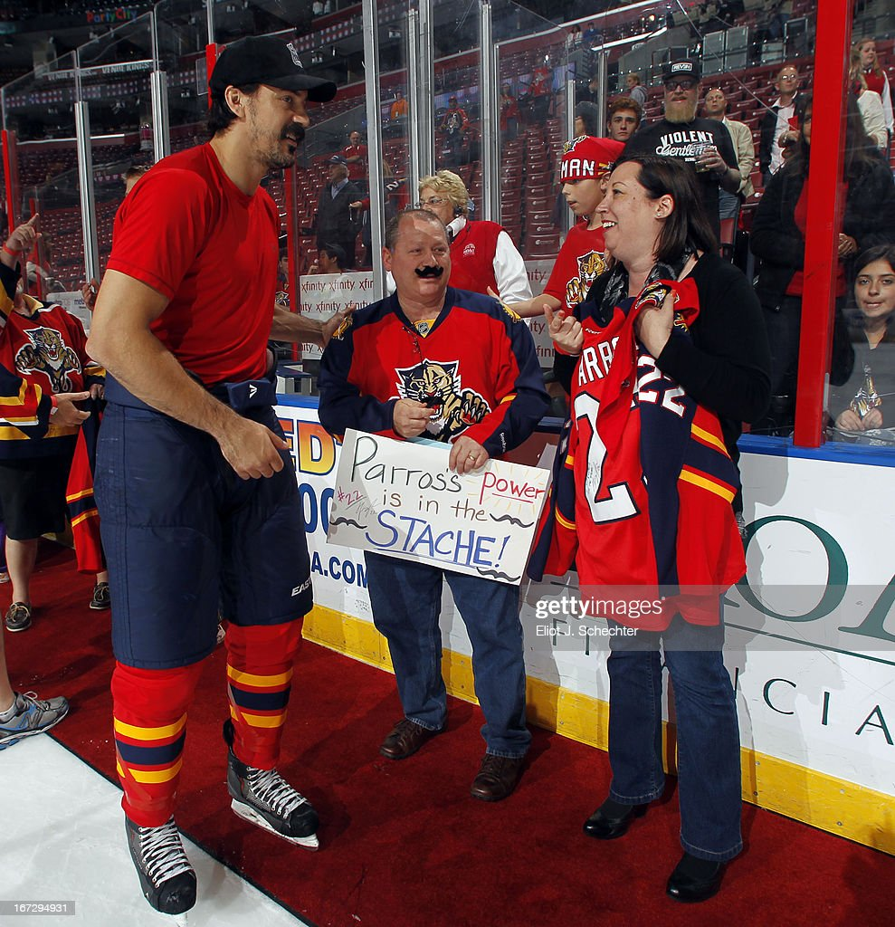 <a gi-track='captionPersonalityLinkClicked' href=/galleries/search?phrase=George+Parros&family=editorial&specificpeople=557239 ng-click='$event.stopPropagation()'>George Parros</a> #22 of the Florida Panthers smiles with fans who won his jersey in auction after beating the New York Rangers at the BB&T Center on April 23, 2013 in Sunrise, Florida.